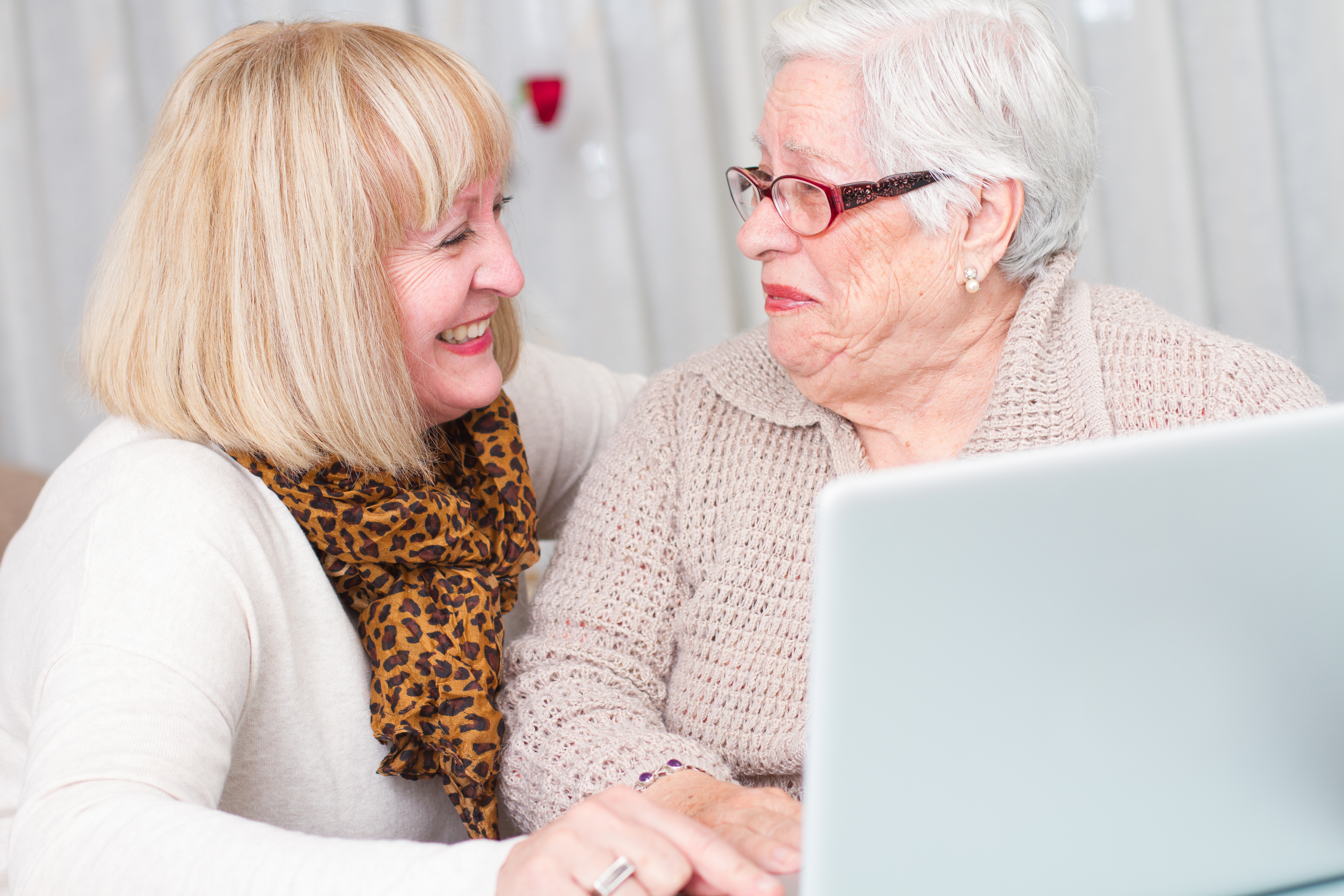 Learning Internet. Grandmother watching her daughter while teaches her elderly mother using a computer